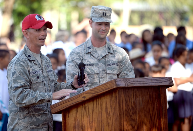 U.S. Air Force Lt. Col. Ryan Elliott, New Horizons Honduras commander and 823rd RED HORSE deputy commander and Grove City, Pa., speaks at the groundbreaking ceremony at the Gabriela Mistral primary school in Ocotoes Alto, Honduras, June 1, 2015. U.S. Air Force Capt. Austin McKinney, 8th Air Force Life Cycle Management Center deputy program manager out of Hanscom Air Force Base, Mass., and Canton, Mich., native, translates. The event also acted as an official start to the New Horizons exercise which will take place in and around the Trujillo and Tocoa areas. New Horizons was launched in the 1980s and is an annual joint humanitarian assistance exercise that U.S. Southern Command conducts with a partner nation in Central America, South America or the Caribbean. The exercise improves joint training readiness of U.S. and partner nation civil engineers, medical professionals and support personnel through humanitarian assistance activities. (U.S. Air Force photo by Capt. David J. Murphy/Released)