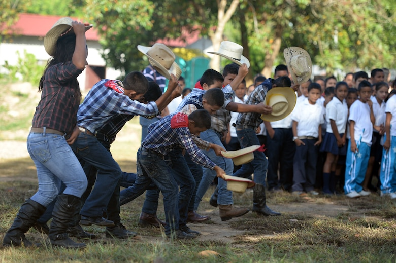 Gabriala Mistral students perform a traditional dance during the groundbreaking ceremony on the Gabriela Mistral school grounds in Ocotoes Alto, Honduras, June 1, 2015. The groundbreaking celebrated the beginning of construction on a new two-classroom building and marked the beginning of the New Horizons Honduras 2015 training exercise taking place in and around the Trujillo and Tocoa areas. New Horizons was launched in the 1980s and is an annual joint humanitarian assistance exercise that U.S. Southern Command conducts with a partner nation in Central America, South America or the Caribbean. The exercise improves joint training readiness of U.S. and partner nation civil engineers, medical professionals and support personnel through humanitarian assistance activities. (U.S. Air Force photo by Capt. David J. Murphy/Released)