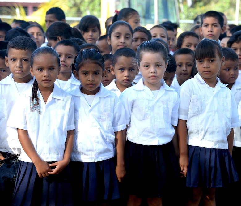 Gabirela Mistral school children form up before the groundbreaking ceremony at the school in Ocotoes Alto, Honduras, June 1, 2015. The children performed a number of dance routines as part of the ceremony which also marked the first day of the New Horizons Honduras 2015 training exercise taking place in and around the Trujillo and Tocoa areas. New Horizons was launched in the 1980s and is an annual joint humanitarian assistance exercise that U.S. Southern Command conducts with a partner nation in Central America, South America or the Caribbean. The exercise improves joint training readiness of U.S. and partner nation civil engineers, medical professionals and support personnel through humanitarian assistance activities. (U.S. Air Force photo by Capt. David J. Murphy/Released)