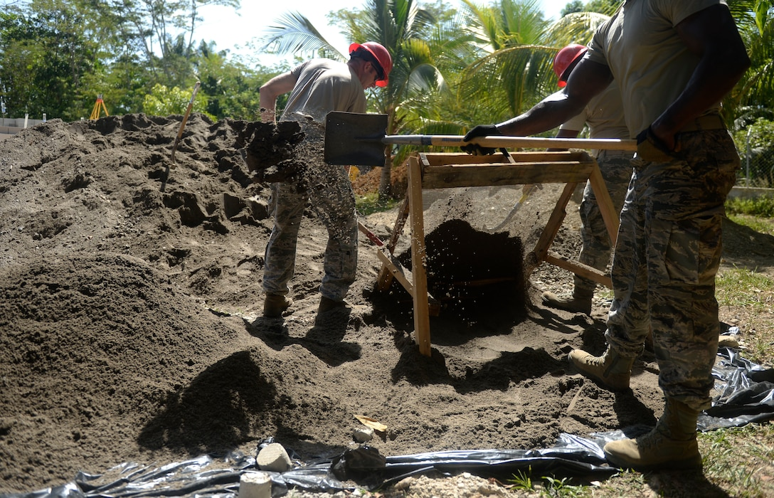 Members of the 823rd Expeditionary RED HORSE Squadron use a screen to sift through dirt, which will be used to create mortar for the bricks used in the creation of the new building at the Gabriela Mistral school in Ocotoes Alto, Honduras, June 1, 2015. The RED HORSE members are in Honduras to participate in a New Horizons training exercise taking place throughout Trujillo and Tocoa. New Horizons was launched in the 1980s and is an annual joint humanitarian assistance exercise that U.S. Southern Command conducts with a partner nation in Central America, South America or the Caribbean. The exercise improves joint training readiness of U.S. and partner nation civil engineers, medical professionals and support personnel through humanitarian assistance activities. (U.S. Air Force photo by Capt. David J. Murphy/Released)
