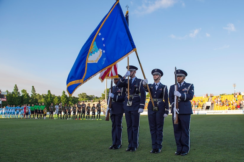 Joint Base Charleston Honor Guard posts the colors during the Charleston Battery soccer team's military appreciation night held at Blackbaud Stadium on Daniel Island, S.C., May, 30 2015. The team wore camouflage uniforms and provided free tickets to any service member, retiree or spouse who presented a military ID. Charleston Battery won the match 1-0(U.S. Air Force by Staff Sgt. William A. O'Brien)