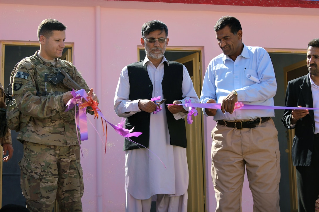 U.S. Army Lt. Col. Zachary L. Miller, left, and Afghan officials participate in the ribbon-cutting ceremony for the only orphanage in Parwan, Afghanistan, May 14, 2015. Miller is commander, Task Force Solid, assigned to the 101st Airborne Division.