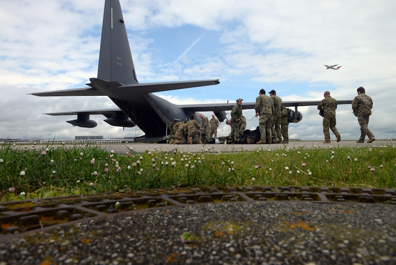 Operators from U.S. Special Operations Command -- Europe prepare prior their gear before a high-altitude, low-opening jump May 30, 2015, over Mont Saint-Michele, France. The paratroopers jumped from an MC-130J Commando II assigned to the 67th Special Operations Squadron from as high as 13,000 feet to commemorate the 71st anniversary of the liberation of France during World War II. (U.S. Air Force photo by Staff Sgt. Micaiah Anthony)