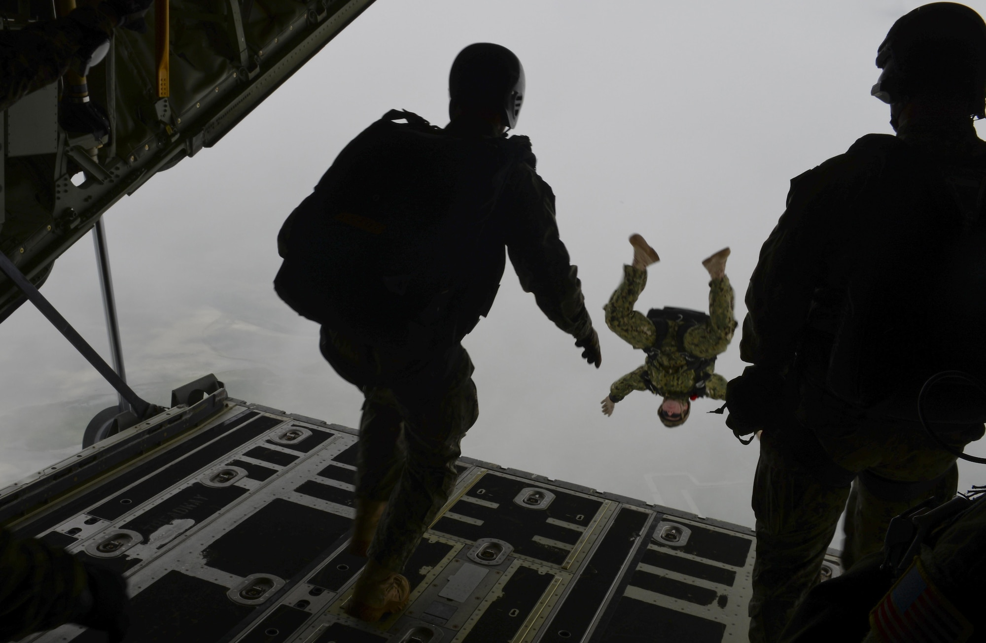 Operators from U.S. Special Operations Command -- Europe free fall during a high-altitude, low-opening jump May 30, 2015, over Mont Saint-Michele, France. The paratroopers jumped from an MC-130J Commando II assigned to the 67th Special Operations Squadron from as high as 13,000 feet to commemorate the 71st anniversary of the liberation of France during World War II. (U.S. Air Force photo by Staff Sgt. Micaiah Anthony)