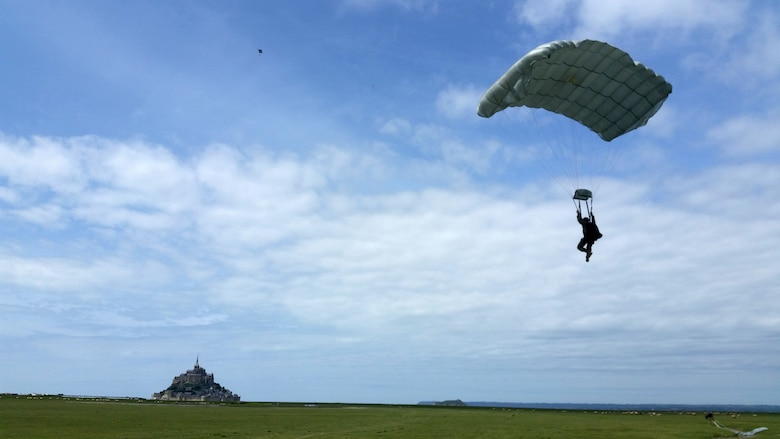 A U.S. Special Operations Command in Europe operator prepares to land just outside of the Mont Saint Michel Abbey in Normandy, France, on May 30, 2015, to commemorate the 71st anniversary of the liberation of France as well as those who served in World War II. Air Commandos assigned to the 321st Special Tactics Squadron, along with other operators within SOCEUR, perform military free fall jumps outside of the U.N. designated world heritage site. (U.S. Air Force photo by Maj. Christina Hoggatt)