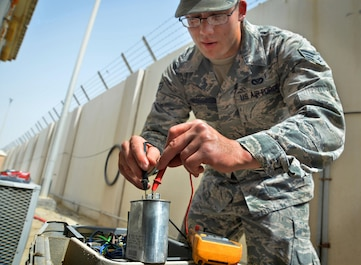 Senior Airman Trent, heating, ventilation and air conditioning journeyman, conducts a diagnostic test on a split AC unit at an undisclosed location in Southwest Asia May 7, 2015. HVAC Airmen are responsible for installing, operating, maintaining, and repairing heating, ventilation, air conditioning and refrigeration systems, combustion equipment, and industrial air compressors. (U.S. Air Force photo/Tech. Sgt. Jeff Andrejcik)