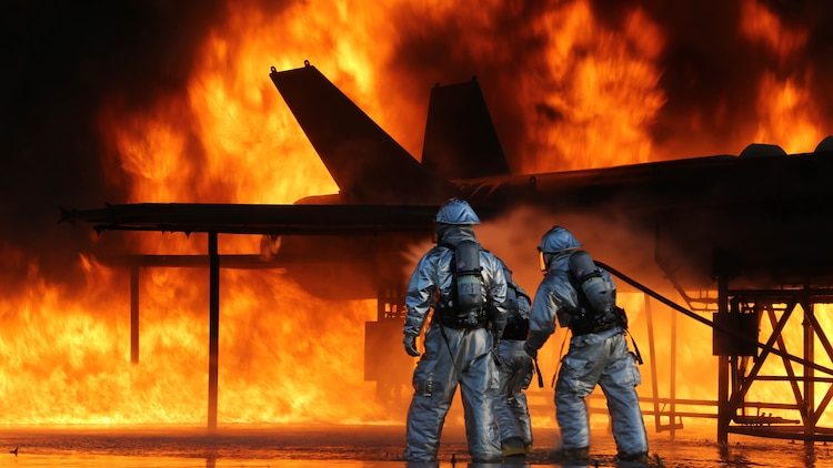 Marines with Aircraft Rescue and Fire Fighting battle the blaze as part of monthly training to ensure they are always prepared in the event of an emergency on the flight line. The ARFF Marines are a part of Headquarters and Headquarters Squadron aboard Marine Corps Air Station Beaufort.