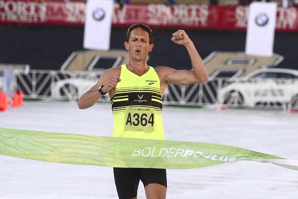 Major Benjamin Payne crosses the finish line first at 2015 Bolder Boulder 10K in Boulder, Colorado. A member of the Air Force World Class Athlete Program at U.S. Air Force Academy, Payne is preparing for the 2016 Olympic Trials in Los Angeles where he will compete for the chance to go to the 2016 Olympics in Rio de Janeiro. Payne finished Bolder Boulder with a runtime of 30 minutes, 41.25 seconds. (Courtesy photo)
