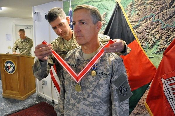 Gordon Simmons (right), chief of engineering, USACE Savannah District, currently deployed to Afghanistan, receives the Bronze Order of the de Fleury Medal from Col. Pete Helmlinger, commander, USACE Transatlantic- Afghanistan District,  Monday at Bagram Airfield, Afghanistan.