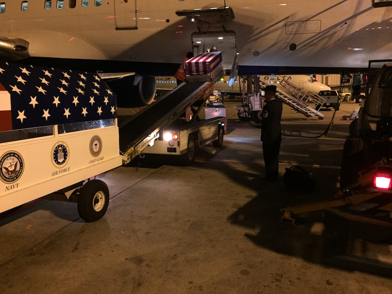 U.S. Air Force Master Sgt. Anthony J. Soupley, 312th Training Squadron Special Instruments superintendent, salutes the casket of Airman 1st Class Chris Evans, 312th Training Squadron Special Instruments student, at the Hartsfield-Jackson Airport in Atlanta, Ga., December 18, 2014. Soupley escorted Evans to his home in California, where he was buried. (Courtesy photo)