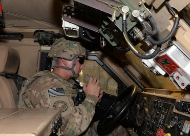 U.S. Air Force Senior Airman Tyler Simpson, 455th Expeditionary Security Forces Squadron combat patrolman, sits in a Mine-Resistant Ambush Protected vehicle awaiting instruction May, 29, 2015, at Bagram Air Field, Afghanistan.  Simpson, who's duties of protecting the base include, flight line entry control checker, flight line security patrolman and first responder to all incidents on the base, is part of the last few 'thousand' Airmen here that have a hand in delivering technology and courage to protect the base and our Afghans partners. (U.S. Air Force photo by Senior Airman Cierra Presentado/Released)