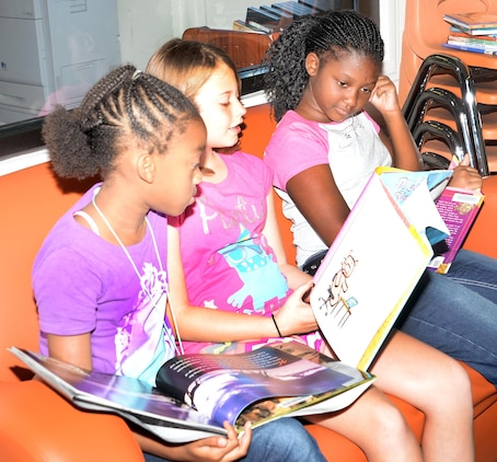 "Children read their favorite books in the Children's Library Room at Marine Corps Logistics Base Albany's Library during the 2015 Summer Reading Program, June 3. This year's program is themed ""Read to the Rhythm."""