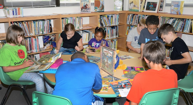 "More than 10 children, ages 5-12, read their favorite books in the Children's Library Room at Marine Corps Logistics Base Albany's Library during the 2015 Summer Reading Program, June 3. This year's program is themed ""Read to the Rhythm."""