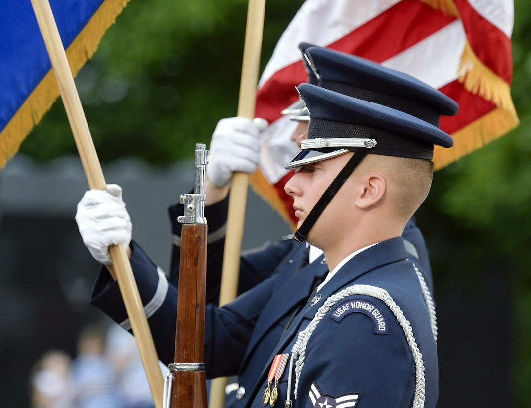 A U.S. Air Force Honor Guardsman presents the colors during the opening ceremonies of the inaugural performance of the 2015 U.S. Air Force Band Summer Concert Series at the Air Force Memorial in Arlington, Va., May 29, 2015.  (U.S. Air Force photo/Andy Morataya)