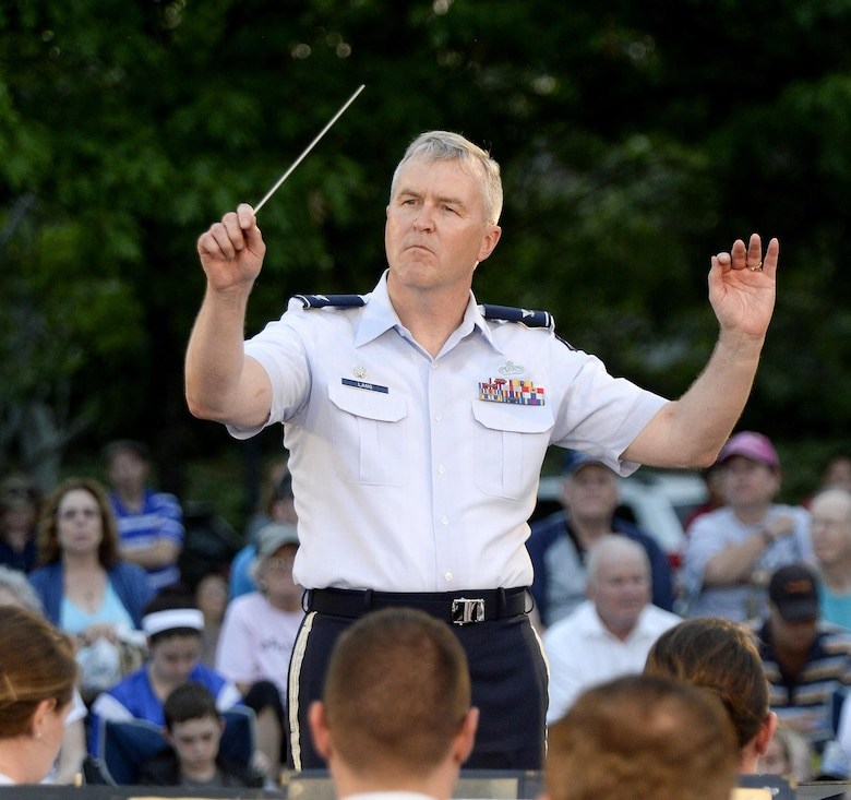 Col. Larry Lang, commander of the U.S. Air Force Band, conducts the inaugural performance of the 2015 U.S. Air Force Band Summer Concert Series at the Air Force Memorial in Arlington, Va., May 29, 2015. (U.S. Air Force photo/Andy Morataya)