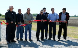 Posing at the ribbon cutting are (from the left): USACE Civil Engineer Mark Nelson, Schuyler City Council Member Ted Marxsen, Omaha District Commander Col. Cross Joel Cross, City of Schuyler Mayor David Reinecke, and Mike Murren from the Lower Platte North Natural Resources District.