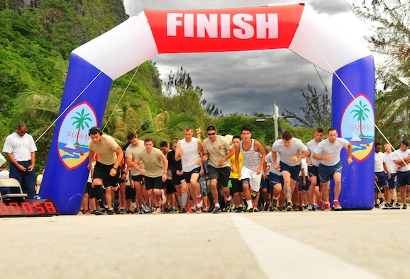 Runners take off for the Rock 'n' Roll 5K, June 3, 2015, at Tarague Beach on Andersen Air Force Base, Guam. Some attendees completed the run dressed in rock music-themed costumes. (U.S. Air Force photo by Senior Airman Alexander W. Riedel/Released)