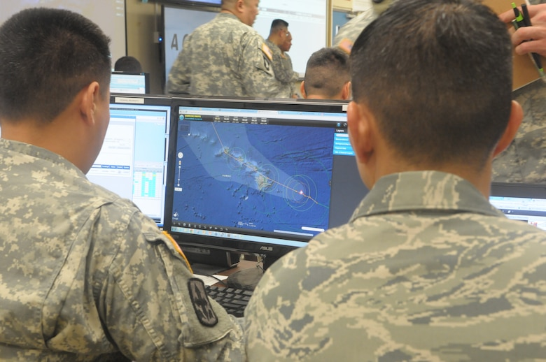 Hawaii National Guardsmen track a simulated hurricane during the exercise Vigilant Guard/Makani Pahili 2015 at the Joint Task Force 5-0 command center in the Hawaii National Guard (HING) Diamond Head Headquarters, Hawaii on June 1, 2015. The exercise provides an opportunity for the State of Hawaii and National Guard to improve collaborative efforts in regards to emergency preparation, coordination, response and recovery with federal, regional, local, civilian and military partners during domestic emergencies and catastrophic events. (U.S. Air National Guard photo by Airman 1st Class Robert Cabuco)