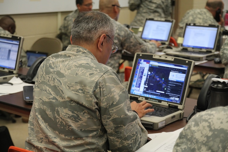 U.S. Air Force Maj. Dana Uehara, 199th Weather Flight, Hawaii Air National Guard, reviews simulated weather tracking data of Hurricane Makani during the Vigilant Guard/Makani Pahili 2015 exercise at the Joint Task Force 5-0 command center in the Hawaii National Guard (HING) Diamond Head Headquarters, Hawaii on June 2, 2015. Uehara serves as the Staff Weather Officer in a traditional Guardsman position and also serves as a civilian satellite analyst for the 17th Operations Weather Squadron on the Active Duty side.  (U.S. Air National Guard photo by Airman 1st Class Robert Cabuco)