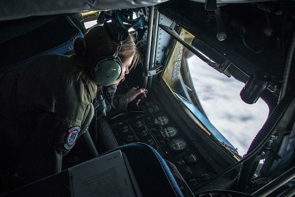 Staff Sgt. Shawna Sims, a 92nd Air Refueling Squadron KC-135 Stratotanker boom operator from Fairchild Air Force Base, Wash., connects with an F-22 Raptor fighter during aerial refueling on the way to exercise AMALGAM DART 15-2 at Eielson AFB, Alaska, May 27, 2015, over British Columbia, Canada. The exercise spanned two forward operating locations in Canada's Northwest Territory, two U.S. Air Force bases in Alaska and a mobile radar site in Resolute, Nunavut, as well as, the skies over much of the North American Aerospace Defense Command's area of responsibility. (U.S. Air Force photo/Staff Sgt. Benjamin W. Stratton)
