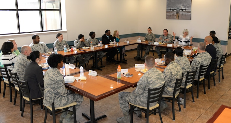 Mary Dixon, Defense Manpower Data Center director, speaks with members of Team Barksdale about operational systems, ID cards and the security they provide on Barksdale Air Force Base, Louisiana, May 28, 2015. Dixon visited the base from the Office of the Under Secretary of Defense Personnel & Readiness to present the 2nd Force Support Squadron with the 2014 Real-time Automated Personnel Identification Data System Site of the Year Award. The award is presented to a site that greatly exceeds standards by adopting new procedures or tools that benefit customer service. The 2nd FSS team was chosen above more than 1,640 teams throughout the Department of Defense. (U.S. Air Force photo/Airman 1st Class Curt Beach)
