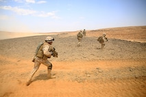 1505011-M-WA276-107: JORDAN (May 11, 2015) Italian Marines run towards an objective after exiting  an Assault Amphibious Vehicle with Kilo Company, Battalion Landing Team 3rd Battalion, 6th Marine Regiment, 24th Marine Expeditionary Unit, during platoon attack drills, as part of Exercise Eager Lion 2015, in Jordan, May 11, 2015. Eager Lion is a recurring multinational exercise designed to strengthen military-to-military relationships, between partner nations and enhance regional security and stability. The 24th MEU is embarked on the ships of the Iwo Jima Amphibious Ready Group and deployed to maintain regional security in the U.S. Fifth Fleet area of operations. (U.S. Marine Corps photo by Lance Cpl. Dani A. Zunun)