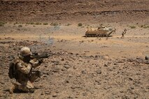 1505011-M-WA276-123: JORDAN (May 11, 2015) An Italian Marine provides security as members of his platoon exit an Assault Amphibious Vehicle with Kilo Company, Battalion Landing Team 3rd Battalion, 6th Marine Regiment, 24th Marine Expeditionary Unit, during platoon attack drills, as part of Exercise Eager Lion 2015, in Jordan, May 11, 2015. Eager Lion is a recurring multinational exercise designed to strengthen military-to-military relationships, between partner nations and enhance regional security and stability. The 24th MEU is embarked on the ships of the Iwo Jima Amphibious Ready Group and deployed to maintain regional security in the U.S. Fifth Fleet area of operations. (U.S. Marine Corps photo by Lance Cpl. Dani A. Zunun)