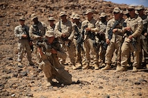 1505014-M-WA276-027: JORDAN (May 14, 2015) Lance Cpl. Dustin Quggins, a rifleman with Kilo Company, Battalion Landing Team 3rd Battalion, 6th Marine Regiment, 24th Marine Expeditionary Unit, demonstrates weapons procedures for the M32 Multi-shot Grenade Launcher, in preparation for a live-fire exercise, as part of Exercise Eager Lion 2015, in Jordan, May 14, 2015. Eager Lion is a recurring multinational exercise designed to strengthen military-to-military relationships, between partner nations and enhance regional security and stability. The 24th MEU is embarked on the ships of the Iwo Jima Amphibious Ready Group and deployed to maintain regional security in the U.S. 5th Fleet area of operations. (U.S. Marine Corps photo by Lance Cpl. Dani A. Zunun)