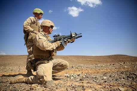 1505014-M-WA276-254: JORDAN (May 14, 2015) Lance Cpl. James Harris, a rifleman with Kilo Company, Battalion Landing Team 3rd Battalion, 6th Marine Regiment, 24th Marine Expeditionary Unit, loads a 40 mm practice round into an M203 Grenade Launcher before conducting a live-fire exercise, as part of Exercise Eager Lion 2015, in Jordan, May 14, 2015. Eager Lion is a recurring multinational exercise designed to strengthen military-to-military relationships, between partner nations and enhance regional security and stability. The 24th MEU is embarked on the ships of the Iwo Jima Amphibious Ready Group and deployed to maintain regional security in the U.S. 5th Fleet area of operations. (U.S. Marine Corps photo by Lance Cpl. Dani A. Zunun)