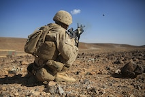 1505014-M-WA276-411: JORDAN (May 14, 2015) Cpl. Miguel Ordonez, a squad leader with Kilo Company, Battalion Landing Team 3rd Battalion, 6th Marine Regiment, 24th Marine Expeditionary Unit, fires an M203 Grenade Launcher during a live-fire exercise, as part of Exercise Eager Lion 2015, in Jordan, May 14, 2015. Eager Lion is a recurring multinational exercise designed to strengthen military-to-military relationships, between partner nations and enhance regional security and stability. The 24th MEU is embarked on the ships of the Iwo Jima Amphibious Ready Group and deployed to maintain regional security in the U.S. 5th Fleet area of operations. (U.S. Marine Corps photo by Lance Cpl. Dani A. Zunun)