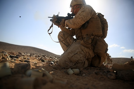 1505014-M-WA276-438: JORDAN (May 14, 2015) Lance Cpl. Dustin Quiggins, a rifleman with Kilo Company, Battalion Landing Team 3rd Battalion, 6th Marine Regiment, 24th Marine Expeditionary Unit, fires an M203 Grenade Launcher during a live-fire exercise, as part of Exercise Eager Lion 2015, in Jordan, May 14, 2015. Eager Lion is a recurring multinational exercise designed to strengthen military-to-military relationships, between partner nations and enhance regional security and stability. The 24th MEU is embarked on the ships of the Iwo Jima Amphibious Ready Group and deployed to maintain regional security in the U.S. 5th Fleet area of operations. (U.S. Marine Corps photo by Lance Cpl. Dani A. Zunun)