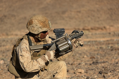 1505014-M-WA276-566: JORDAN (May 14, 2015) Cpl. Juan Hernandez, a small arms technician with Combat Logistics Battalion 24, 24th Marine Expeditionary Unit, prepares to fire an M32 Multi-shot Grenade Launcher, during a live-fire exercise, as part of Exercise Eager Lion 2015, in Jordan, May 14, 2015. Eager Lion is a recurring multinational exercise designed to strengthen military-to-military relationships, between partner nations and enhance regional security and stability. The 24th MEU is embarked on the ships of the Iwo Jima Amphibious Ready Group and deployed to maintain regional security in the U.S. 5th Fleet area of operations. (U.S. Marine Corps photo by Lance Cpl. Dani A. Zunun)