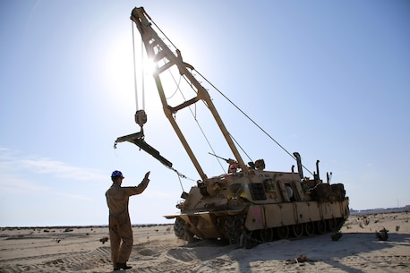 Sergeant Cody L. Olson, a main battle tank technician with the 24th Marine Expeditionary Unit's Logistics Combat Element, Combat Logistics Battalion 24, guides an M88A2 Hercules Recovery Vehicle during Exercise Iron Magic outside of Al Hamra Military Base at United Arab Emirates, Feb. 8, 2015. (U.S. Marine Corps photo by Sgt. Devin Nichols)