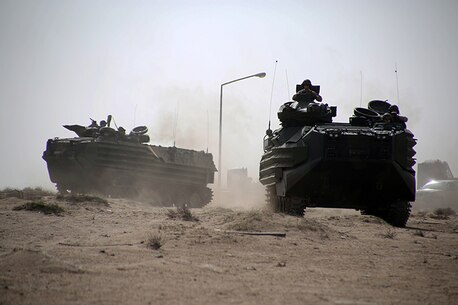 Amphibious Assault Vehicles from Kilo Company, Battalion Landing Team 3rd Battalion, 6th Marine Regiment, 24th Marine Expeditionary Unit, move to an objective during a simulated amphibious assault as part of Exercise Eagle Resolve 2015 at Failaka Island, Kuwait, March 23, 2015. Eagle Resolve is the premiere Arabian Peninsula/gulf region exercise among the United States, Gulf Cooperation Council nations, and international partners. It serves to address regional challenges associated with asymmetric/unconventional warfare in a multi-national environment. (U.S. Marine Corps photo by Sgt. Devin Nichols)