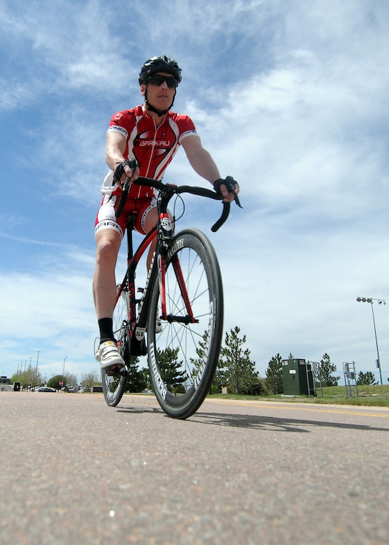 Derek Hamby, the 50th Space Wing Manpower and Organization chief, goes for a lunchtime bicycle ride at Schriever Air Force Base, Colo., May 28, 2015. Six months after sustaining life-threatening injuries from a serious bicycling accident, Hamby is preparing for a 100-mile mountain bike race. (U.S. Air Force photo/Staff Sgt. Debbie Lockhart)