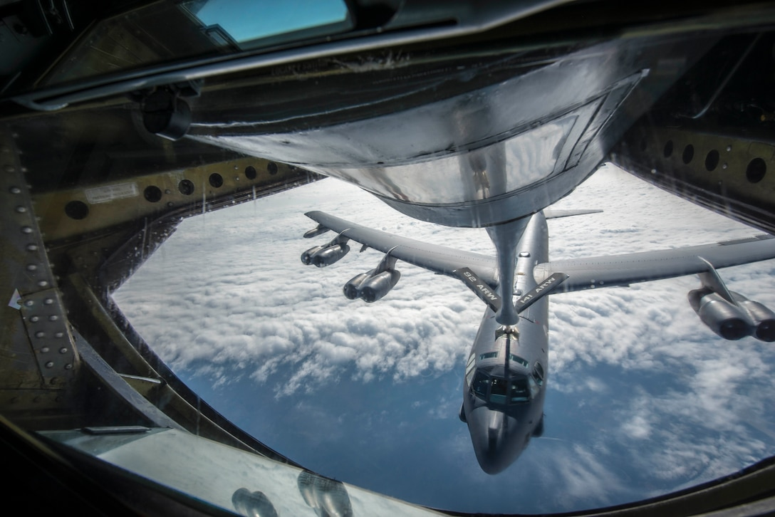 A KC-135 Stratotanker connects with a B-52H Stratofortress from Minot Air Force Base, N.D., during an aerial refueling mission over the Alaskan coastline as part of exercise Amalgam Dart 15-2 May 28, 2015. The annual North American Aerospace Defense Command exercise affords American and Canadian forces field training aimed at improving NORAD's operational capability in a binational environment. The exercise spanned two forward operating locations in Canada's Northwest Territories, two U.S. Air Force bases in Alaska, and a mobile radar site in Resolute, Nunavut, as well as the sky over much of NORAD's area of responsibility. (U.S. Air Force photo/Staff Sgt. Benjamin W. Stratton)