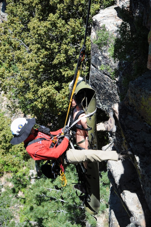 Brandon Othon, Coconino County search and rescue member, prepares to move a simulated patient up a steep cliffside during Angel Thunder 2015 high angle rescue training at Mongollon Rim, Ariz., June 3, 2015. Angel Thunder is the world's largest personnel recovery exercise, hosting 11 partner nations and nine interagencies with a common goal to train personnel recovery forces to prepare, plan, execute and adapt for a rescue mission.  (U.S. Air Force photo by Senior Airman Betty R. Chevalier/Released)