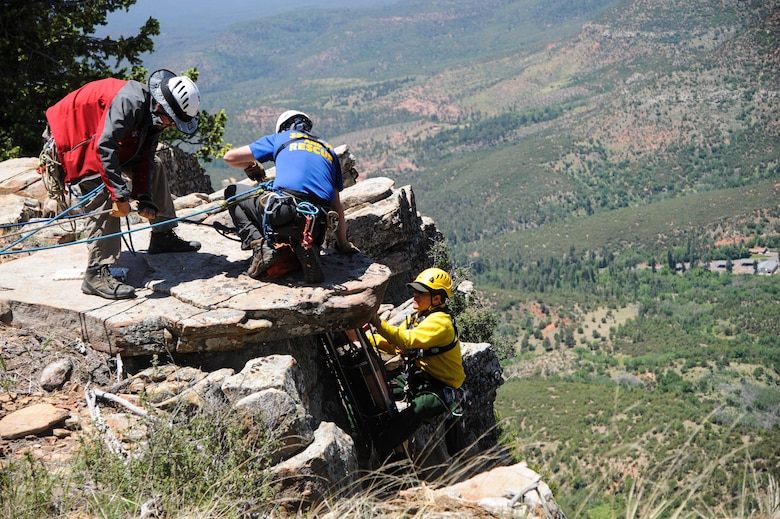 Members of several interagency search and rescue teams hoist a simulated patient up a cliffside during Angel Thunder 2015 high angle rescue training at Mongollon Rim, Ariz., June 3, 2015. Angel Thunder is the largest personnel recovery exercise in the world combining joint, coalition and interagency personnel. Participants will train through the full spectrum of personnel recovery capabilities with numerous types of aircraft. (U.S. Air Force photo by Senior Airman Betty R. Chevalier/Released)