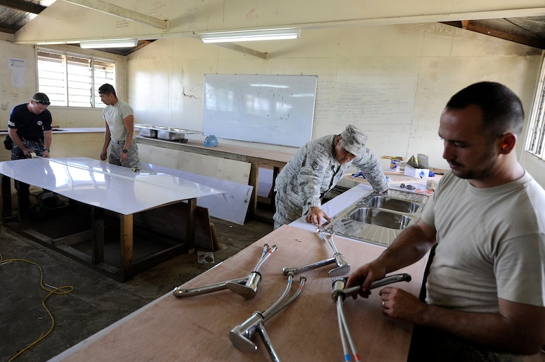 New Zealand Army and U.S. Air Force plumbers and carpenters install sinks and build counters for science lab at Gahuku Primary School in the Eastern Highlands Providence, Papua New Guinea, June 2, 2015. Pacific Angel is a U.S Pacific Command multilateral humanitarian assistance civil military operation, which improves military-to-military partnerships in the Pacific while also providing medical health outreach, civic engineering projects and subject matter exchanges among partner forces. (U.S. Air Force photo by Staff Sgt. Marcus Morris/Released)