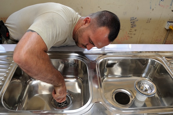 U.S. Air Force Senior Airman Stephen Pond, 647th Civil Engineer Squadron plumber, Joint Base Pearl Harbor-Hickam, Hawaii, installs a sinks for a science lab at Gahuku Primary School in the Eastern Highlands Providence, Papua New Guinea, June 2, 2015. The mission of Pacific Angel is to upgrade education and health facilities, as well as work to deepen local disaster response capabilities. (U.S. Air Force photo by Staff Sgt. Marcus Morris/Released)