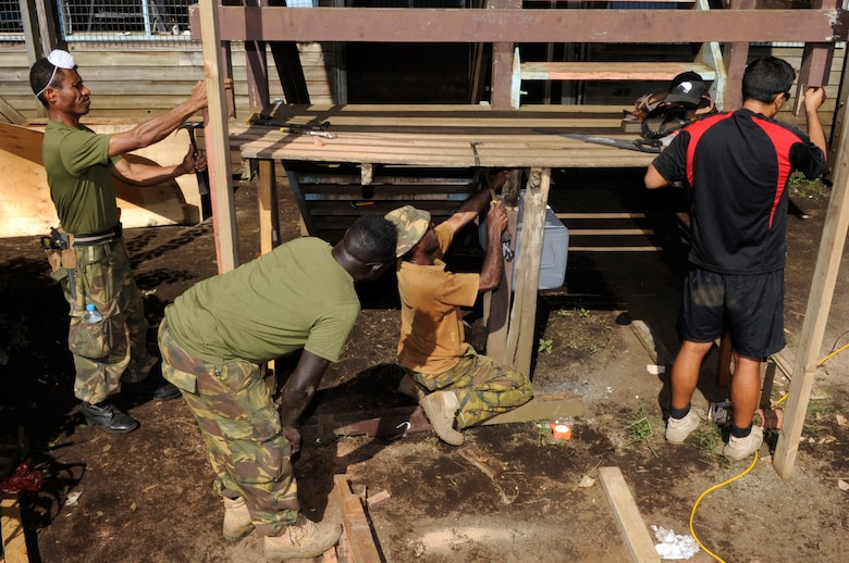 Papua New Guinea Defence Force carpenters and New Zealand Army carpenters repair an unstable staircase during Pacific Angel 15-4 at Gahuku Primary School in the Eastern Highlands Providence, Papua New Guinea, June 2, 2015. Pacific Angel is a U.S Pacific Command multilateral humanitarian assistance civil military operation, which improves military-to-military partnerships in the Pacific while also providing medical health outreach, civic engineering projects and subject matter exchanges among partner forces. (U.S. Air Force photo by Staff Sgt. Marcus Morris/Released)