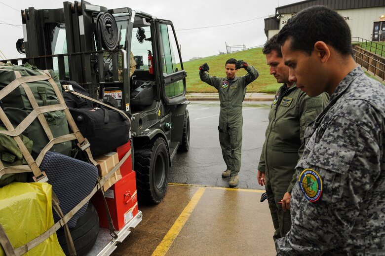 Colombian Air Force members weigh a cargo bundle prior to departure May 21, 2015, at Little Rock Air Force Base, Ark. The U.S. continues to support Colombia's military as they work to thwart narco-terrorist activity in the country. (U.S. Air Force photo by Senior Airman Harry Brexel)