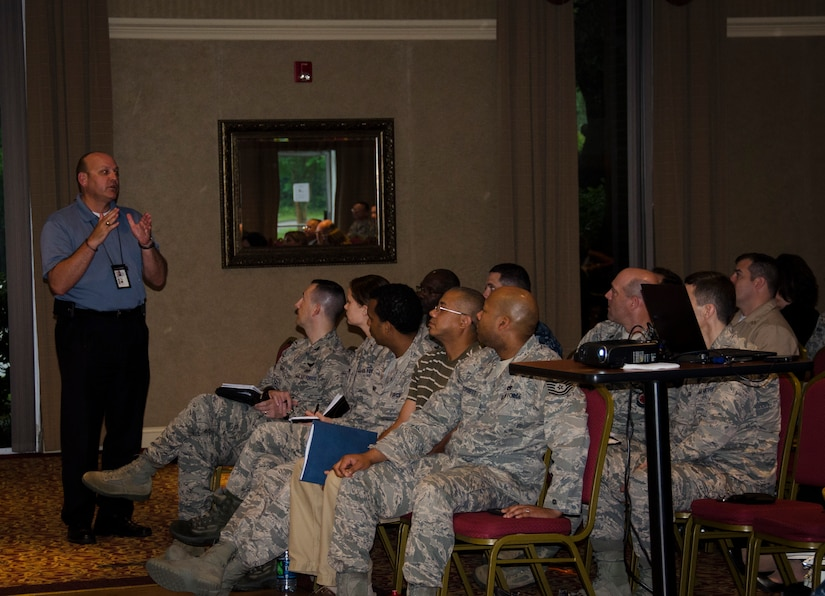 William Scheer, 628th Security Forces Squadron Weapons Station Operations manager, talks to the audience during the Quality of Life Council Meeting, June 3, 2015 at Joint Base Charleston – Weapons Station, S.C. The purpose of the  meeting was to solicit input from base personnel to identify problems and to improve base services. (U.S. Air Force photo/Staff Sgt. AJ Hyatt)