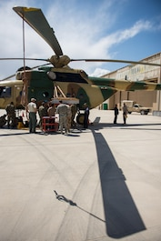 A prototype boresight rack adapter is installed on an Afghan Air Force Mi-17 helicopter at Kabul Air Wing, Afghanistan, May 18, 2015. The boresight rack adapter will be used by the AAF in order to accurately be able to sight their weapons system on their Mi-17 helicopters. (U.S. Air Force photo by Tech. Sgt. Joseph Swafford/Released)