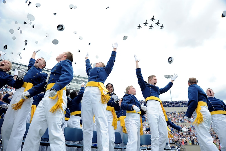 Members of the U.S. Air Force Academy Class of 2015 toss their hats in celebration as the Thunderbirds roar over Falcon Stadium in Colorado Springs, Colo., May 28, 2015. Over 800 cadets graduated and became second lieutenants. Secretary of the Air Force Deborah Lee James gave the graduation address. (Air Force photo/Jason Gutierrez)