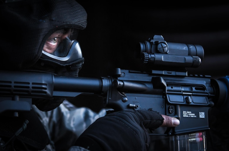 A security forces Airman secures the outside of a hardened facility after neutralizing the opposing force during a combat training course on Ramstein Air Base, Germany, May 30, 2015. The Battlefield Leaders Assaulter Course, Integrated Combat Essentials is designed to teach security forces members from multiple countries advanced tactics and shooting skills for use in the event of a base security breach. (U.S. Air Force photo/Tech. Sgt. Ryan Crane)
