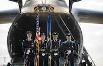 A color guard detail stands in front of a C-5M Super Galaxy in preparation for a retirement ceremony June 1, 2015, at Travis Air Force Base, Calif. Airmen from the Travis Honor Guard supported 1,807 ceremonies in 2014, providing an important service that ensures honor and dignity for the American flag, Air Force flag and flags of visiting dignitaries' native countries. (U.S. Air Force photo/Ken Wright)