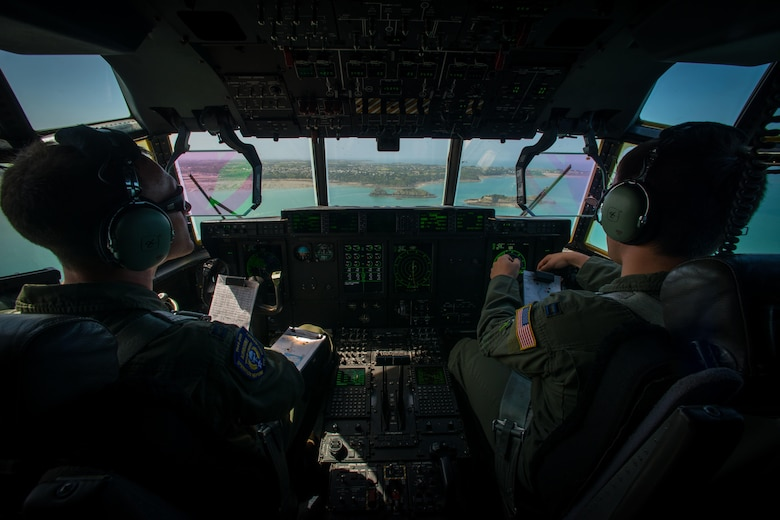 Capts. Lindsey Kinsinger and Chad Thompson, both pilots assigned to the 37th Airlift Squadron, fly over the coast of Normandy, France, June 3, 2015. Over 380 service members from Europe and affiliated D-Day historical units are participating in the 71st anniversary as part of Joint Task Force D-Day 71. The task force, based in Sainte Mere Eglise, France, is supporting local events across Normandy from June 2-8 to commemorate the Allies' actions on D-Day, which continue to resonate 71 years later. (U.S. Air Force photo/Senior Airman Nicole Sikorski)