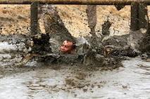 Camp Pendleton is implementing a new washing system during the Mud Run, June 6, 7, 13 and 14, to meet water conservation objectives for Marine Corps Installations - West.  During the Mud Run, 80 percent of water is used at the finish line to wash participants down. Marine Corps Community Services is adopting a more efficient washing system that uses a mixture of soap and warm water to alleviate water consumption concerns.  (Photo by Cpl. Sarah Wolff/Released)