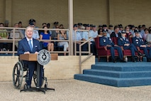 Texas Gov. Greg Abbott  delivers a speech to the graduating class of Airmen at the Basic Military Training parade June 5, 2015 at Joint Base San Antonio-Lackland, Texas. Gov. Abbott was a distinguished visitor at the BMT parade, and addressed the graduating Airmen. (U.S. Air Force photo by Benjamin Faske)